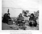 Group of Eskimo women around cooking fire, Alaska, ca. 1904
