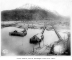 Skagway, showing wharves and steamship unloading passengers in foreground,  ca. 1909