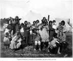 Eskimo women and children in front of tents, Teller, ca. 1905