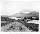 First passenger train over Nome River bridge, Seward Peninsula Railway, Nome, July 17, 1906