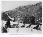 Dogsled and log cabin at the Alaska-Canada border, ca. 1906