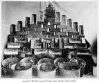 Gold bricks and buckets of gold ore, Nome, 1906