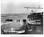 Landing boat on the beach at lightering operation, Nome, August 22, 1904
