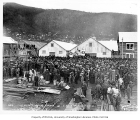 Crowd of people at celebration of U.S. naval victories during the Spanish-American War, Dawson,...