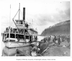 Steamboat MONARCH with passengers at river landing, ca. 1904