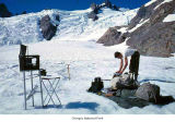Researcher conducting ice crystal study at Blue Glacier, Olympic National Park, ca. 1965