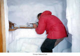 Ice strength test conducted by a researcher probably in an ice shaft in a glacier, Olympic...
