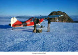 Fairchild airplane at Snow Dome outside which two men are standing, Olympic National Park, date...