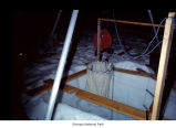 Researcher outside ice shaft in darkness, Snow Dome, Mount Olympus, Olympic National Park, date...