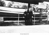 Lester Anthis with Haney next to the Tilicum canoe while serving in the Coast Guard near Ozette...