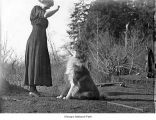Woman with dog, possibly on the Olympic Peninsula, date unknown