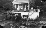 Hildebrand family sitting on the porch outside their house in the Queen Anne neighborhood of...