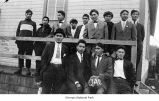 Native American men, probably Quileutes, posing for a group portrait outside a building, possibly...