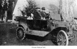 George Marshall and Sam Morse with their children in a car, probably on the Olympic Peninsula, 1915