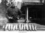 J.E.L. James with fish outside the Hotel Mora in Mora, 1923