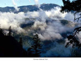 Cox Valley partially covered with clouds viewed from Hurricane Ridge, Olympic National Park, date...