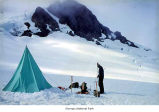Snow Dome showing a researcher hot point drilling, Mount Olympus, Olympic National Park,