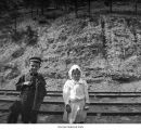 Children near railroad tracks, possibly on the Olympic Peninsula, ca. 1915