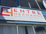 Sign on Exterior of Entre Hermanos Building