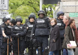 Stand Against Communism Rally: Seattle Police officers in riot gear, some holding batons, Seattle, May 1, 2017