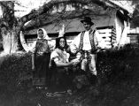 Man, women, and child in costume, Slovakia (Slovak Republic) (former Czechoslovakia), circa...