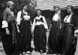 Young Catholic women wearing regional costumes from the 1930s, 1900s, and 1880s, Lipenica region,...