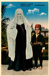 Illustration of woman and boy in costume (Moslem), Banja Luka, Bosnia and Hercegovina (former...