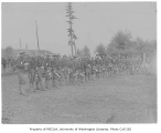 Soldiers lined up for mess call at Fort Lawton,  August 5, 1900