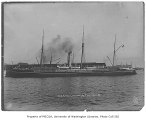 U.S.A.T. ATHENIAN docked in Seattle and preparing to transport troops to China, August 18, 1900