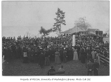 Monument dedication at Alki Point showing Edmond Meany giving an oration,  West Seattle...