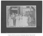 Restaurant workers in front of business with Owl sign in window, Seattle, n.d.