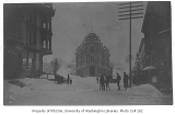 Looking east from the intersection of James St., Yesler Way and 1st Ave. after a snowfall,...