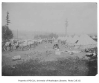 Encampment showing horse stables, soldiers and tents, Fort Lawton, August 1900