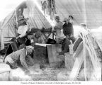 U.S. government military corral in north Seattle showing soldiers making pack saddles in a tent,...
