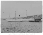U.S.A.T. EGBERT docked at Schwabacher's Wharf and preparing to transport troops to China, Seattle,...