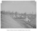 Military corral in Seattle showing tents, soldiers and horses, August 1900