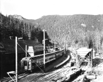 Empire Builder leaving the west portal of the new Cascade Tunnel looking east, ca. 1929