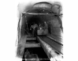 Pioneer train dumping into cars in the main tunnel, ca. 1928