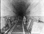 Removing the concrete forms inside the tunnel at Scenic, January 1, 1929