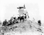 Workers and horses at the forest fire lookout station on Benchmark Mountain, ca. 1930