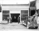 Perry Stroud's garage with tow truck, ca. 1930