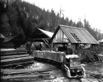 Ore train and miners at the Sunset Copper Mine, November 7, 1929