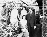 Ashton family in Monroe greenhouse, ca. 1930