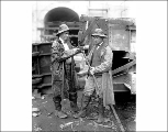 Officials J. C. Baxter and Conroy inspecting a drill bit, ca. 1928