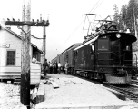 Great Northern Railway loading passengers at the station at Scenic, ca. 1930