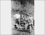 Men posed with Flanders automobile on Index-Galena road, 1911