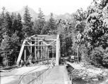 Construction of the state highway bridge over the south fork of the Skykomish River about one mile...