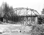 Building the state highway bridge over the south fork of the Skykomish River about one mile from...