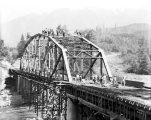 Bridge under construction over the south fork of the Skykomish River about one mile from Index,...