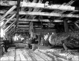 Lumber mill interior with circular saw, Snohomish County, ca. 1913